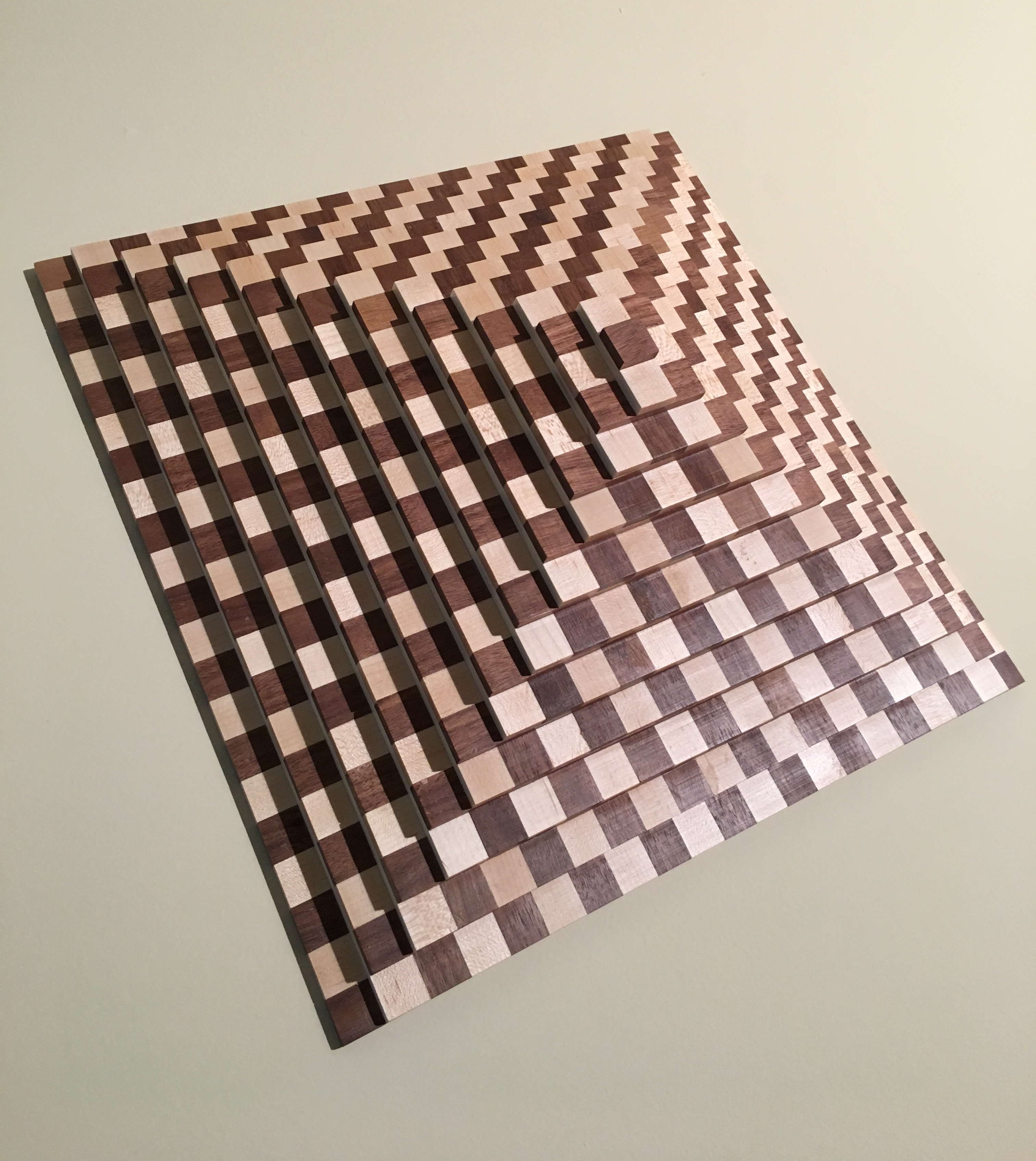 Chestnut and Maple strips layered to form a solid pyramid